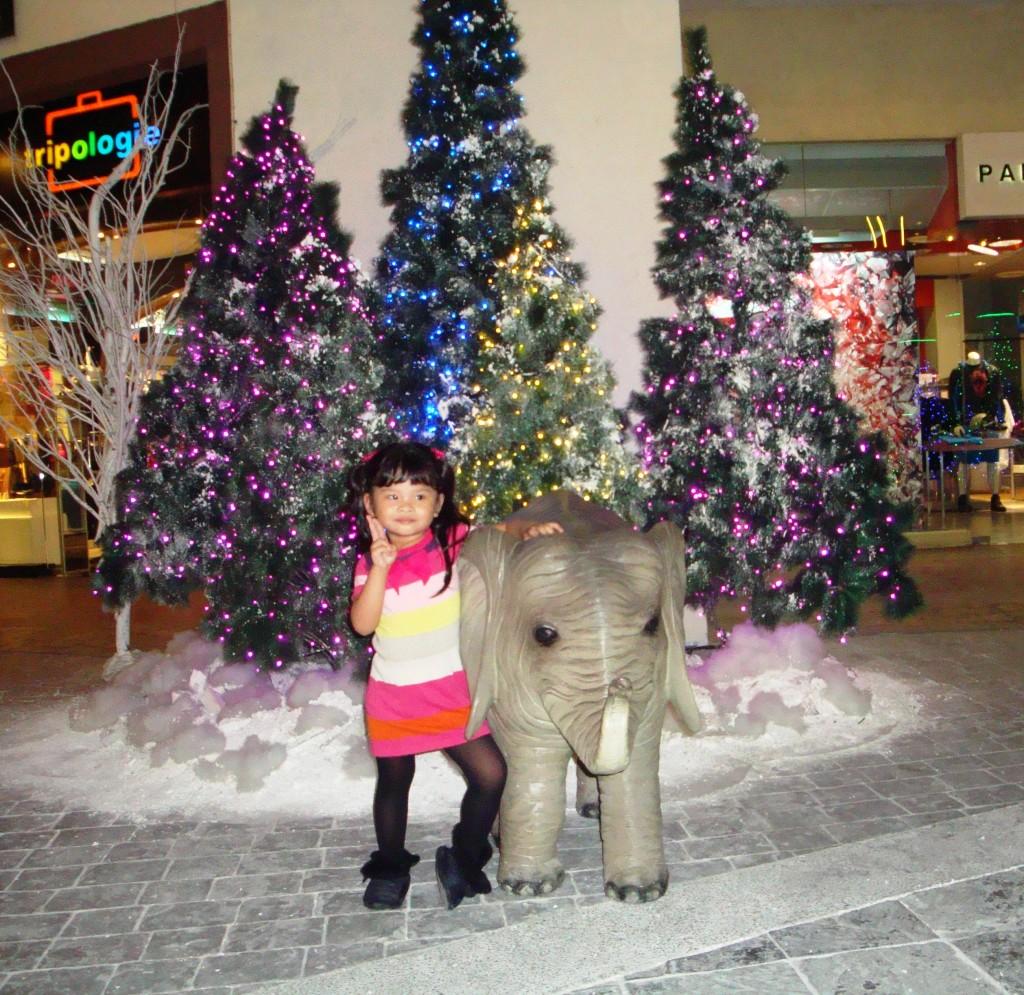 Keisha posing with the little elephant.