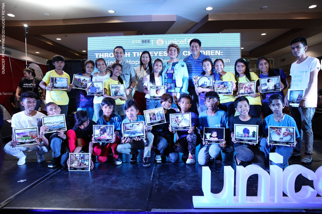 (from L-R): World-renowned UNICEF photographer Giacomo Pirozzi, Sony Philippines' Erica dela Cruz, UNICEF Representative in the Philippines Lotta Sylwander and Tacloban City Mayor Alfred Romualdez with the young photographers and their best photos.