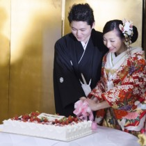 Japanese Bride and Groom cutting a wedding cake